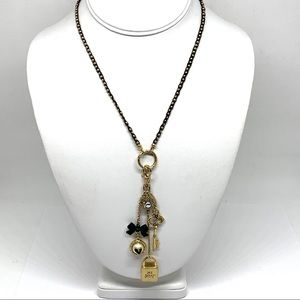 Betsey Johnson Gold Black Necklace Charm Tassel